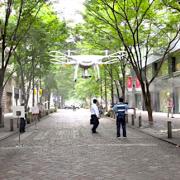 丸の内の高層ビル街における警備・防災・物流領域での活用を視野にドローンの飛行実証実験を三菱地所と実施